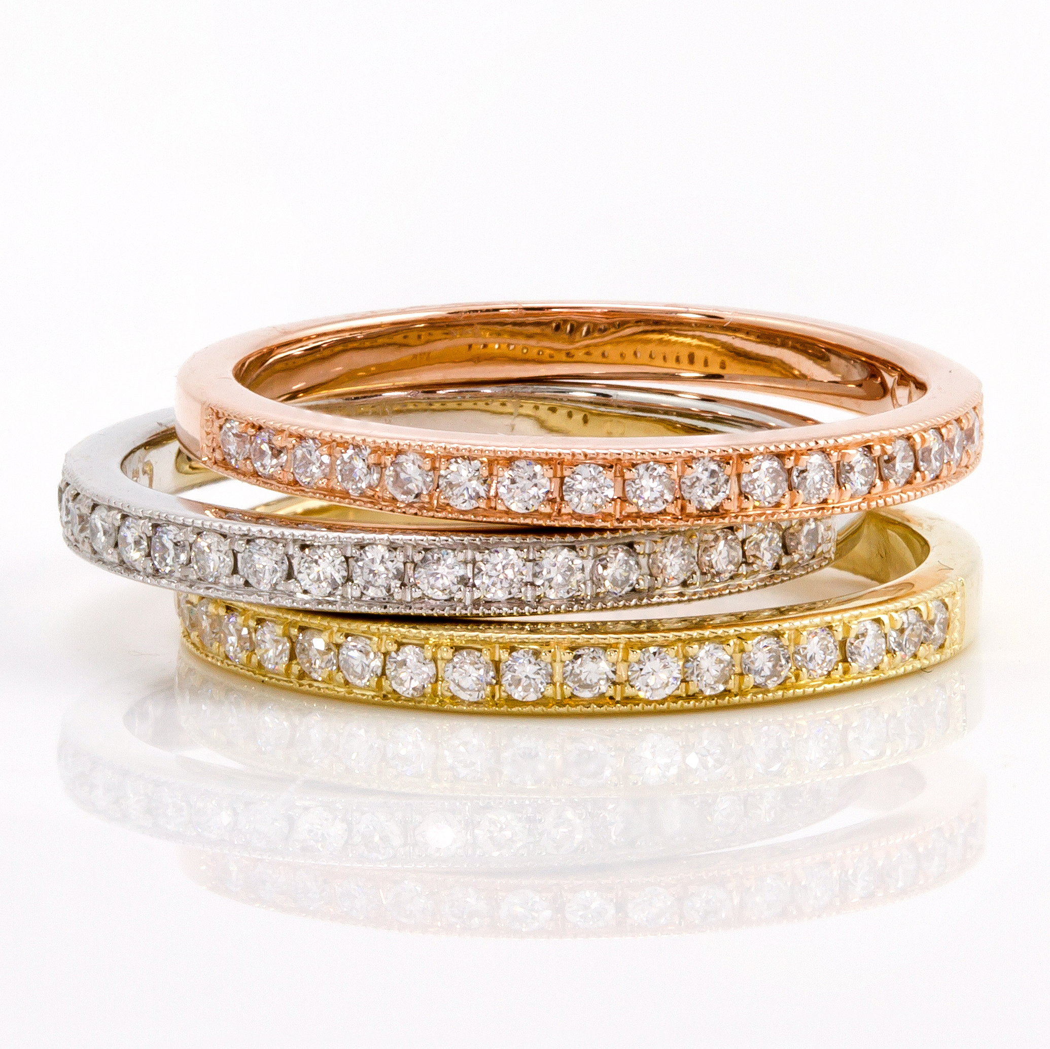 Diamond rings in yellow, white and rose gold